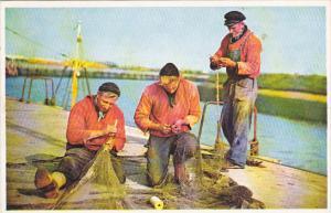 Belgium Fishermen Mending Their Nets
