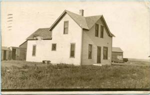 NE - Omaha. Farmhouse and Buildings. Sign on barn says Patton's Sun Proof Pa...