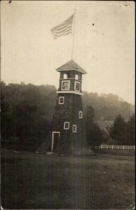 Tower Bldg w/ American Flag - Springfield VT Cancel c1910 Real Photo Postcard