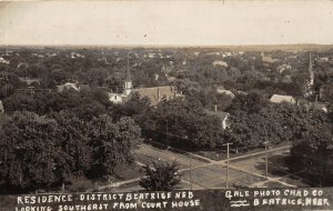 G32/ Beatrice Nebraska RPPC Postcard 1909 Residence District Church