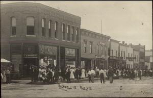 Rockwell IA Busy Street Signs in Store Windows Drug Store Ice Cream RPPC c1910