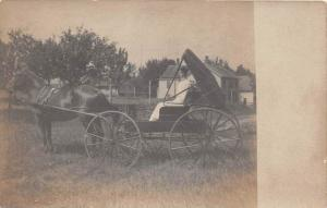 7827 Women in  horse and buggy   RPC