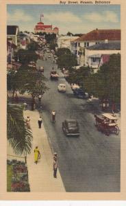 Cars along Bay Street, Nassau, Bahamas, 1930-40s