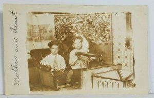 Rppc Darling Children in Faux Town Backdrop & Automobile Studio Postcard O16