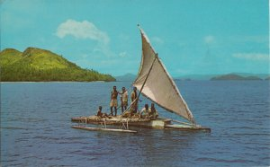 FIJI - FIJIAN OUTRIGGER BOAT - View shows several people posing the boat, 1960s