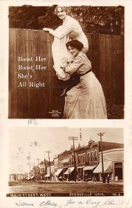 Dyersville Iowa~Main Street Stores~Boost Her Cheer~Ladies Over Fence~1913 RPPC