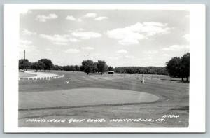 Monticello Iowa~Monticello Golf Club~Golfer Pulls Clubs to 9th Green~1950s RPPC