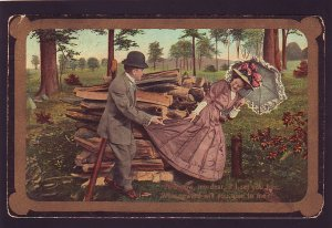P1579 1910 used postcard romance outdoors woodpile what reward will you give me?