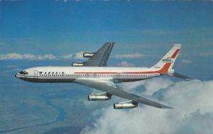 Angled Side View, Passenger Airplane in Flight, Boeing 707-320C Jet, Wardair ...