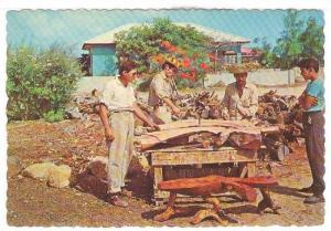 Woodworkers crafting the famous Arubsn Kwihi tables by hand, Aruba, Netherl...