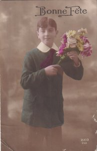 RP: BIRTHDAY, 1900-10s; Young Boy holding bouquet of flowers