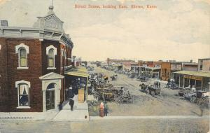 Kiowa Kansas~Main Street~Bank~Peoples Restaurant~Meat Market~Wagons~1908 PC