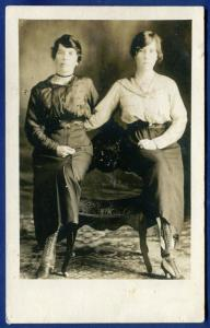 2 Women at photo studio posing with each other real photo postcard RPPC