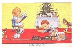 Vrolijk Kerstfeest! Children playing with Christmas toys, dalmation puppy wit...