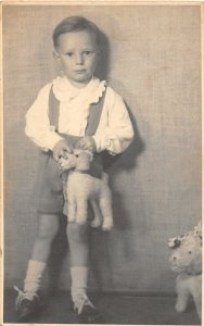 F71/ Interesting Real Photo RPPC Postcard Child Stuffed Dog  c1910 17