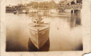 E50/ near Peoria? Illinois Real Photo RPPC Postcard Boat Men Lake c1910