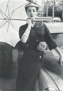 Postcard elegant woman in dress and umbrella