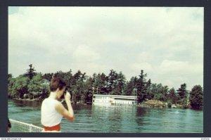 Thousand Islands Ontario Canada - Tour boat lady photographs Thousand Islands