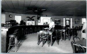 Vintage SNAPSHOT / Real Photo Postcard BAR INTERIOR Beer Signs Cigars Bottles