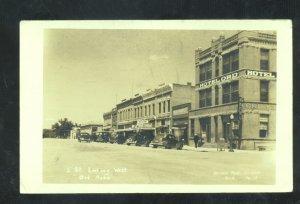 RPPC ORD NEBRASKA DOWNTOWN STREET SCENE 1940's CARS STORES REAL PHOTO POSTCARD