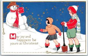 Vintage Christmas Embossed Postcard Girls Surprised by Reclining Snowman UNUSED