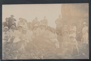 Social History Postcard -Large Group of People Sitting / Standing on Rocks T9806
