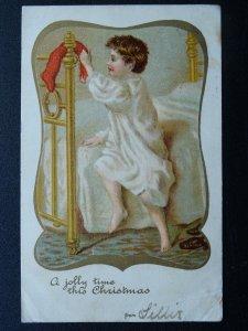 A JOLLY TIME THIS CHRISTMAS Child With Christmas Stocking c1902 UB Postcard