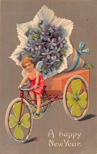 New Year Greetings Angel Riding Bicycle with Flowers Antique Postcard J59877