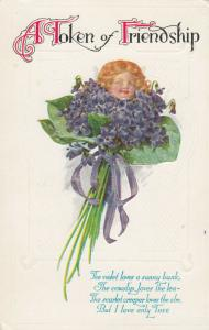 A Token of Friendship GREETING, 00-10s; Girl's head in middle of flower bouquet
