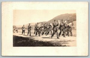 RPPC Marching Band on Elevated Rd in Hilly Region~Trombones Lead~Tuba~Drum~c1914