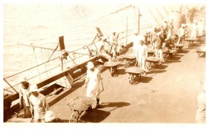 WW 1  Loading Coal on ship , by hand