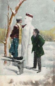 Boy caught making look-alike snowman of friend, 1900-10s