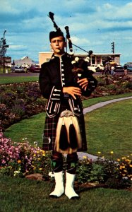 Canada - Nova Scotia. Piper in Tartan Dress