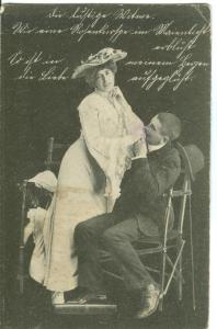 Couple in romantic scene, early 1900s used Postcard