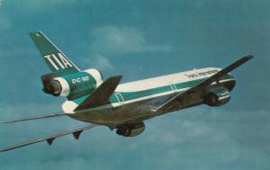 Trans International Airlines DC-10 in flight, 50-70s