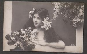 Young Girl Leaning Out Window - Flowers Used 1910s