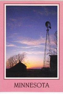 Windmill ans Sunset On A Minnesota Prairie Farm