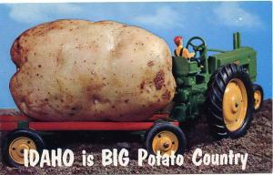 Idaho is Big Potato Country - John Deere Tractor towing a Potato