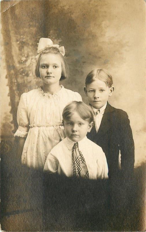 Little Girl w/Bow in Hair~2 Boys, Middle Hair Part, w/Neckties~RPPC c1913