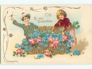 Unused Pre-Linen valentine CUTE GIRL OPENS BASKET OF FLOWERS BESIDE BOY k9244
