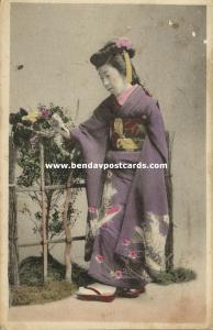 japan, Geisha Lady in Kimono on Cloggs looking at Butterfly (1919)