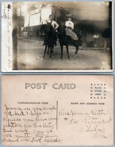 U.S. STREET SCENE COUPLE ON HORSES ANTIQUE REAL PHOTO POSTCARD RPPC w/ FLAGS