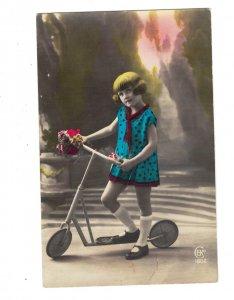 HI1106 VINTAGE TOYS LITTLE ART DECO GIRL BOB HAIR CUT ON HER SCOOTER  RPPC