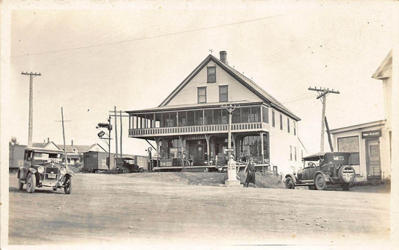 East Wilton ME Gas Station Pumps Railroad Train Cars Grocery Store RPPC Postcard