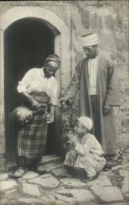 Turkey Publ in Constantinople Turkish Men Drinking Water c1910 RPPC