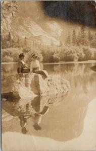 Two Women Sitting Rock Water Postmarked Camp Curry CA 1911 Postcard E50 *As Is