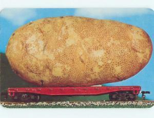 Pre-1980 EXAGGERATION - HUGE IDAHO POTATO ON TRAIN CAR n0406