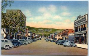 Raton, New Mexico Postcard SECOND STREET Downtown Scene Curteich Linen c1940s