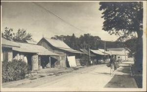 Jamaica Panama or Virgin Islands? Shacks Homes Dirt Road c1915 RPPC myn