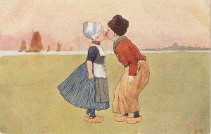 Dutch couple. Romance. The kistss Old vintage antique postcard